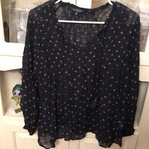 Women's navy blouse with gold star-like print